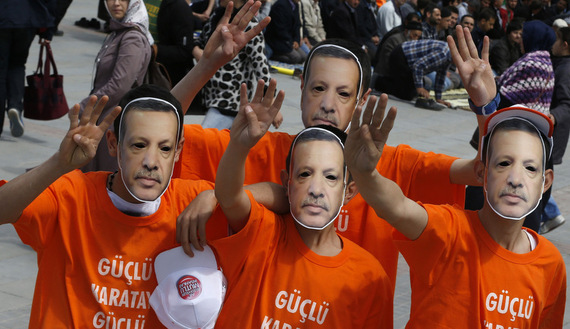 Supporters of the ruling AK Party wear Erdogan masks during an election rally in Konya